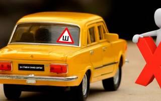 Обязательно ли клеить на машину знак ошипованных колес